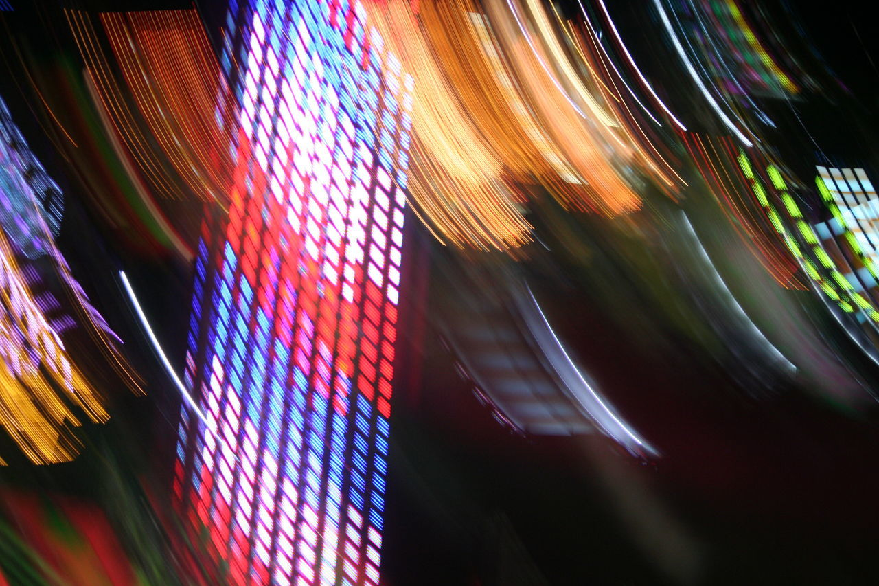Abstract Blurred Motion Capital Lakefair 2016 Carnival Carnival Lights Carnival Lights Multi Colored City Close-up Colorful Fair Fairground Attraction Fairgrounds Ferris Wheel Ferris Wheel View Firework Glowing Illuminated Light Light Trail Motion Multi Colored Night No People Olympia