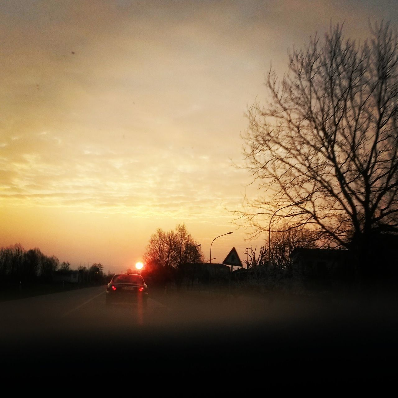 sunset, bare tree, sky, sun, tree, silhouette, no people, car, nature, road, beauty in nature, scenics, outdoors, day