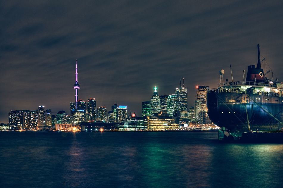 Big city lights and sleepless nights. Night Illuminated Architecture Building Exterior Skyscraper City Cityscape Built Structure Sky Tower Travel Destinations No People Waterfront Urban Skyline Water Outdoors Nautical Vessel Sea Nature Toronto Toronto Canada Ontario Lake Ontario