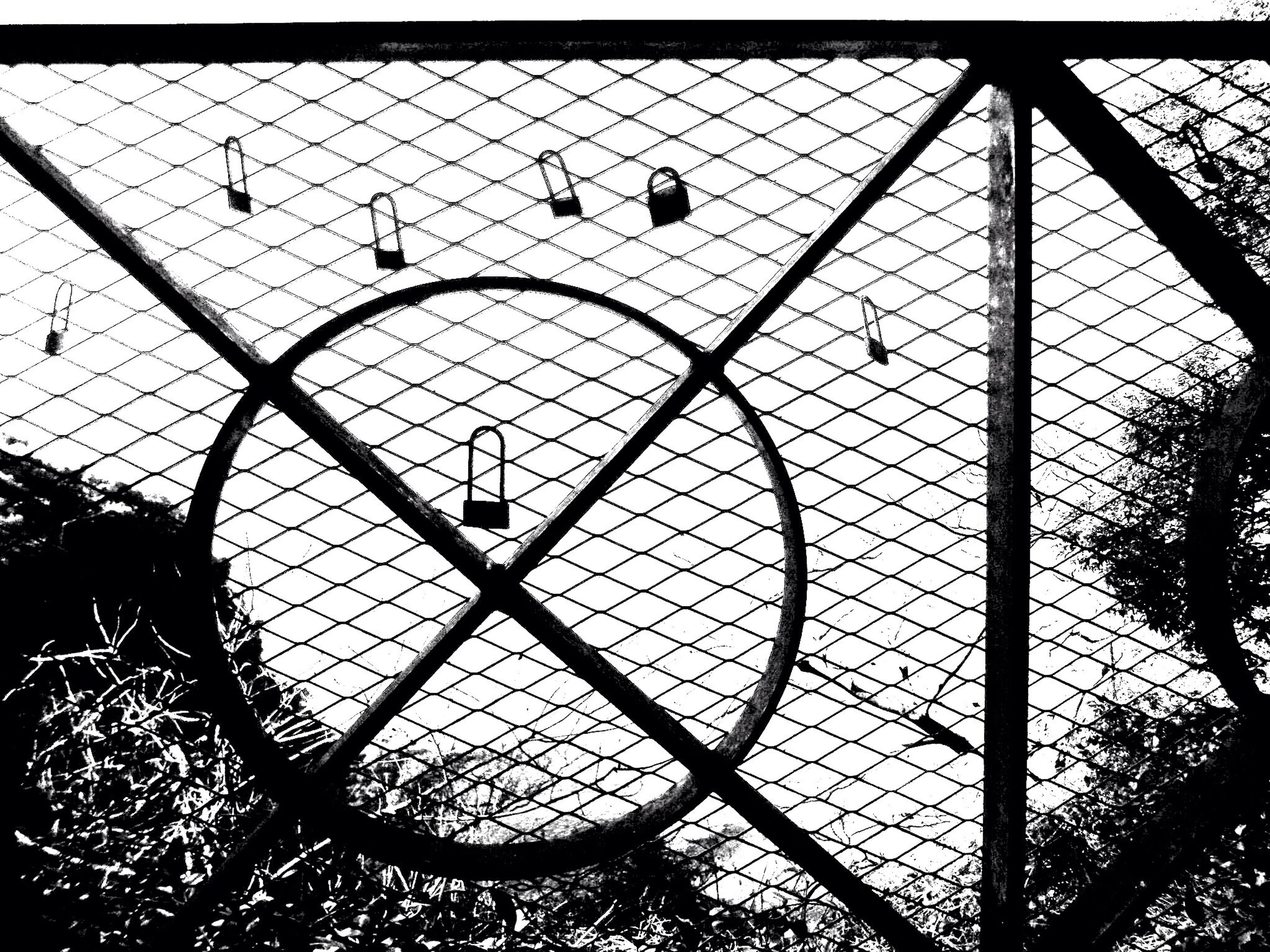metal, safety, chainlink fence, protection, indoors, circle, glass - material, pattern, geometric shape, close-up, window, security, full frame, silhouette, day, fence, sky, backgrounds, metallic, no people