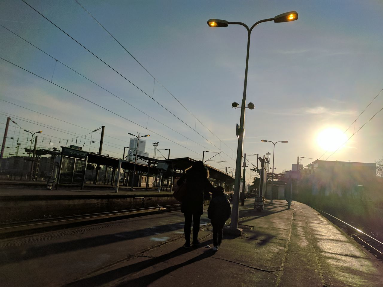 Yet another morning 52WeekChallenge Week1 2 People Train Station Work Day Sun Sunlight Sunlight And Shadow Sunny Day Children Kid Mother Sky Blue Sky France 52weeksplan 52 Weeks 52frames 52