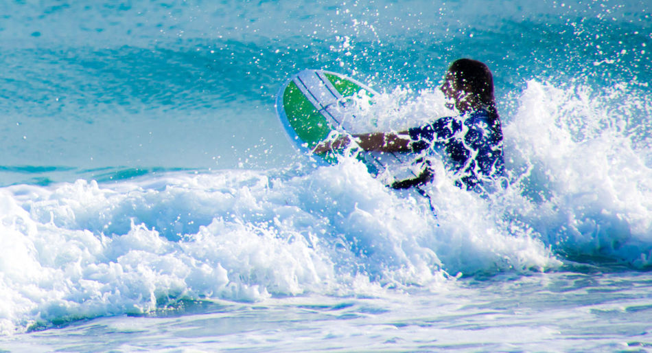 Adult Adults Only Adventure Day Full Length Fun Healthy Lifestyle Leisure Activity Lifestyles Motion Nature One Person Outdoors People Sea Son Serra De Marina Splashing Sport Summer Surfboard Surfing Vacations Water Wave Women Be. Ready. An Eye For Travel