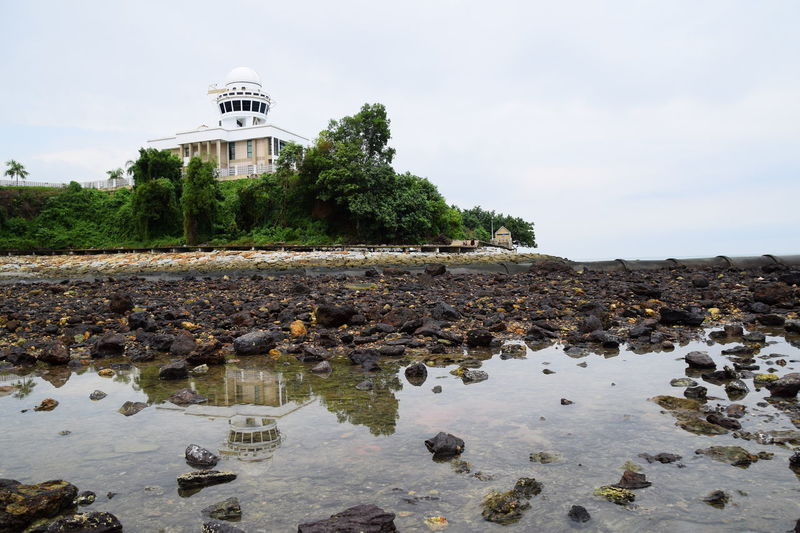 Negeri Sembilan, Malaysia - 9 MAY 2017 : Baitul Hilal, an astronomical observatory in Teluk Kemang, view over the puddle formed from low sea tide during cloudy morning. Water No People Outdoors Day Tree Sky Nature Architecture Observatory Planetarium Astronomy Landscape Building Low Angle View Reflection Malaysia
