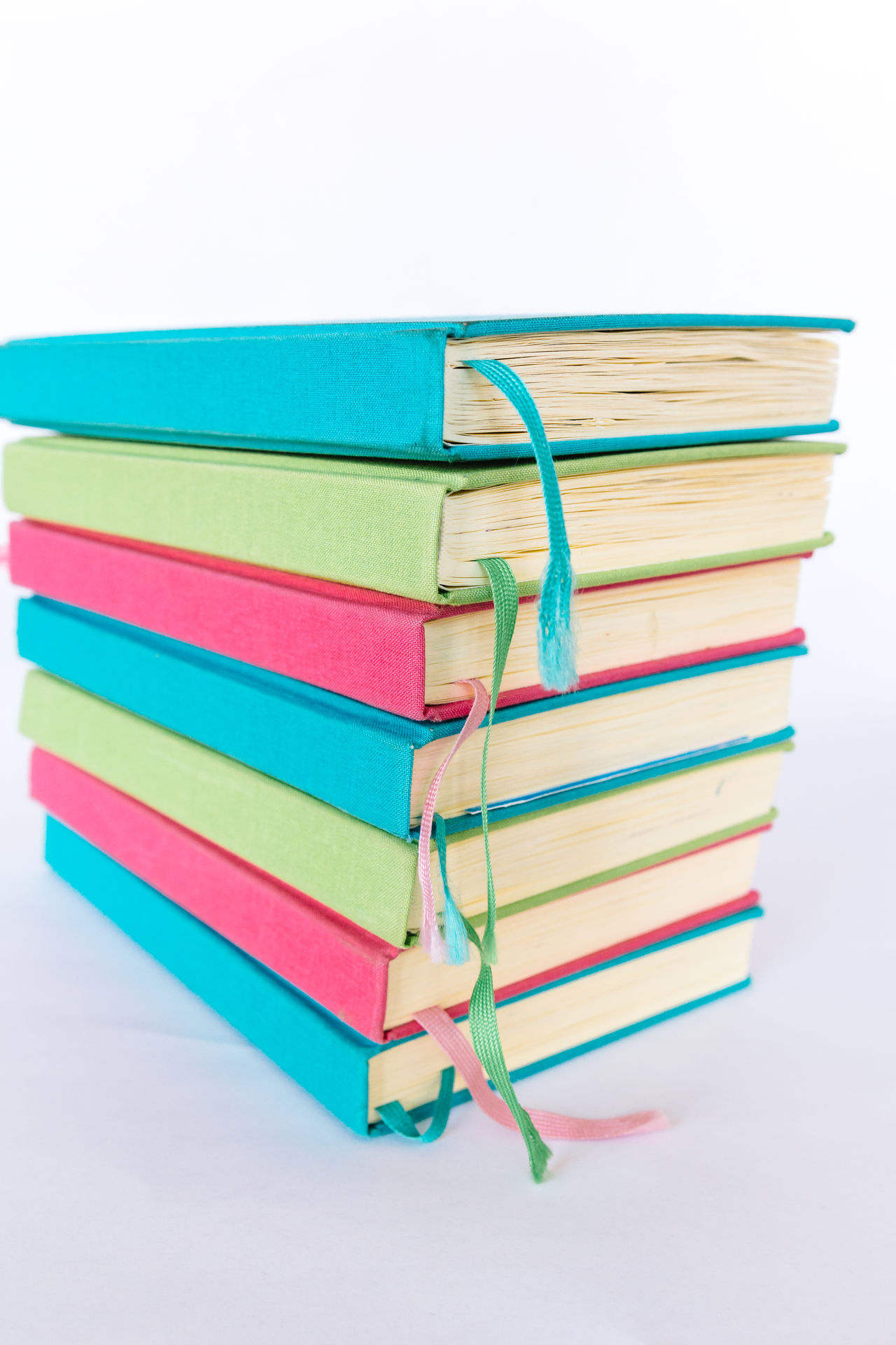 Colorful Books Blue Books Close-up Colorful Colors Cyan Day Education Educational Green Large Group Of Objects Learning LearningEveryday Multi Colored No People Pink Reading Reading Books Reading Time Stack Studio Shot Study Hard Study Time Studying White Background