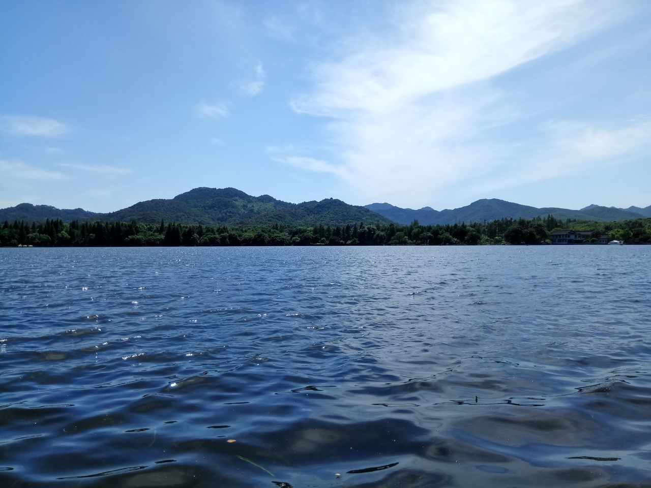 water, nature, tranquility, lake, beauty in nature, outdoors, scenics, sky, tranquil scene, mountain, day, cloud - sky, no people, waterfront, blue, mountain range, tree
