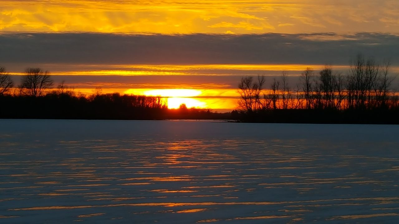 sunset, beauty in nature, scenics, nature, tranquility, orange color, tranquil scene, sky, reflection, no people, lake, water, cloud - sky, idyllic, outdoors, silhouette, cold temperature, winter, tree