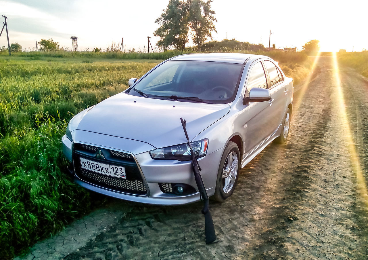 Mitsubishi Lancer in the field. Air rifle at the car bumper. I went to the field to shoot. Agriculture Car Evo Grass Gun Lancer Land Vehicle Mitsubishi Mode Of Transport Nature Outdoors Pneumatic Rifle Road Shoot Silver  Sky Sunbeams Sunset Transportation Walk X