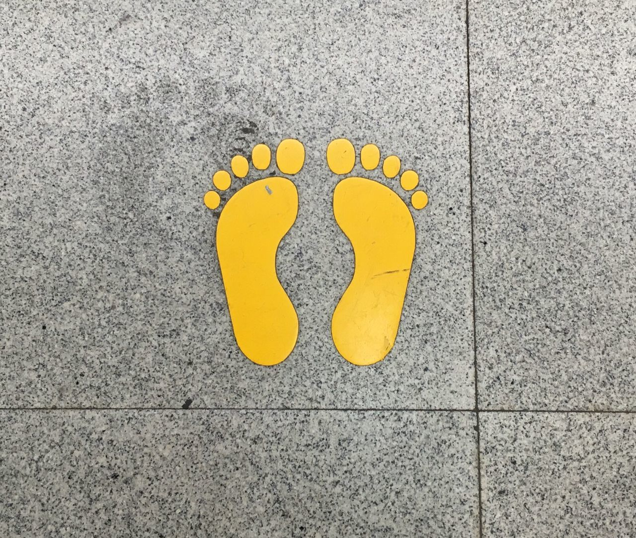 Painted Yellow Feet on Pavement Feet Foot Toes Toe Anatomy Painted Stencil Stencil Art Foot Stencil Shenzhen China Yellow