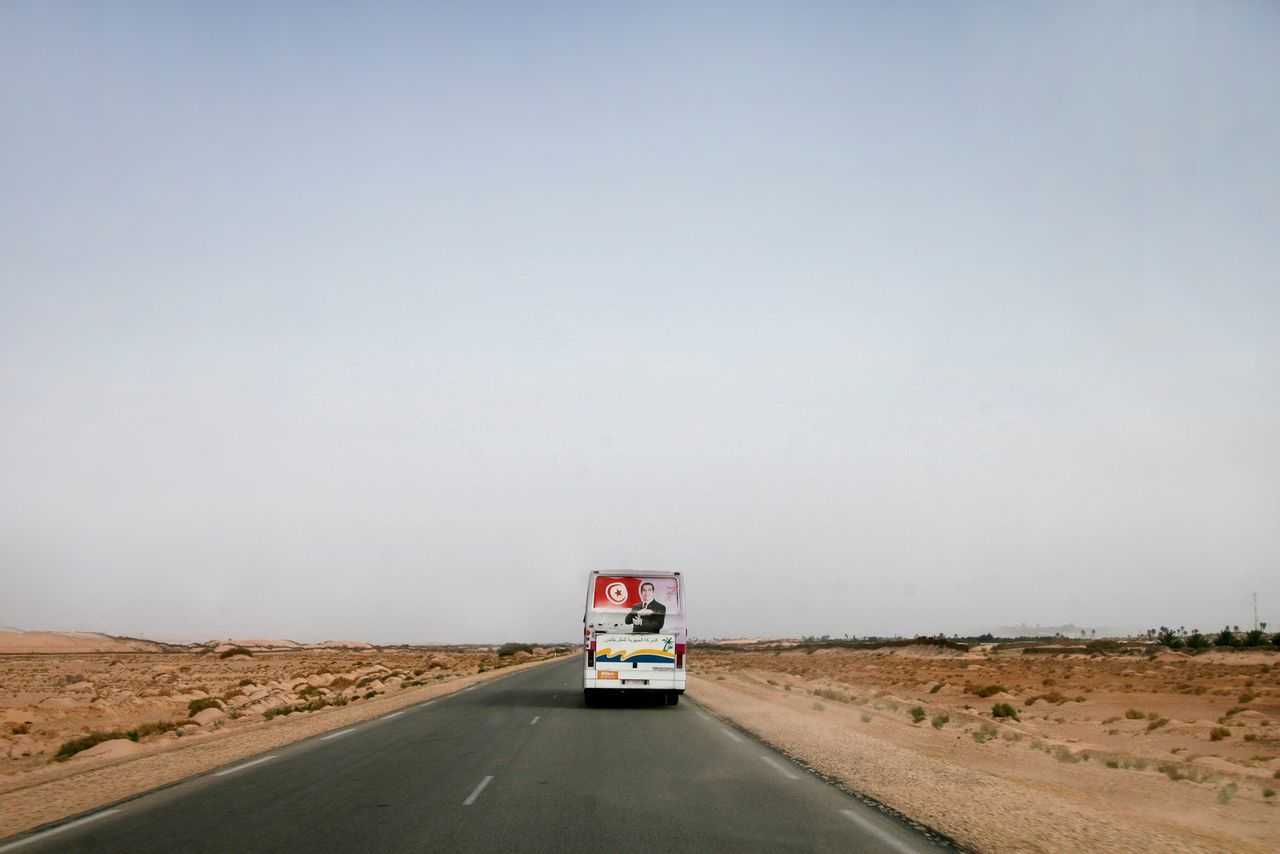 Bus On Empty Road Against Clear Sky