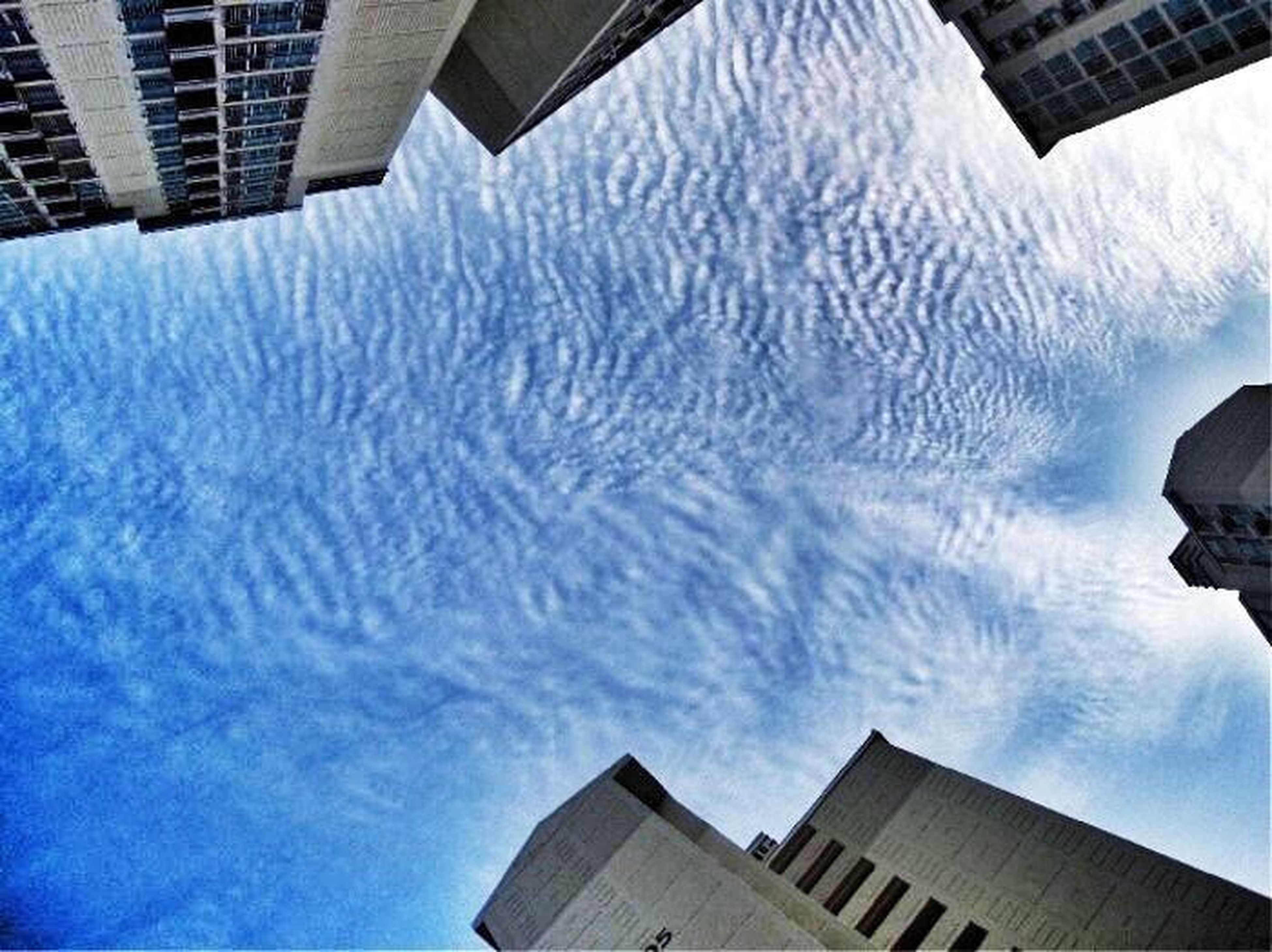 building exterior, architecture, built structure, sky, low angle view, city, building, reflection, blue, cloud - sky, modern, day, tower, outdoors, residential building, residential structure, office building, no people, water, skyscraper
