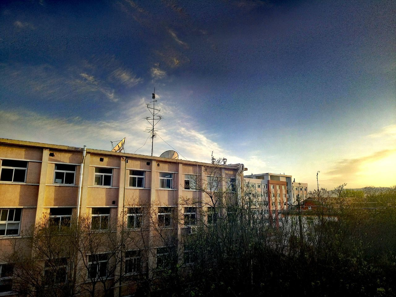 architecture, sky, cloud - sky, building exterior, built structure, no people, outdoors, day, nature, plant, sunset, tree