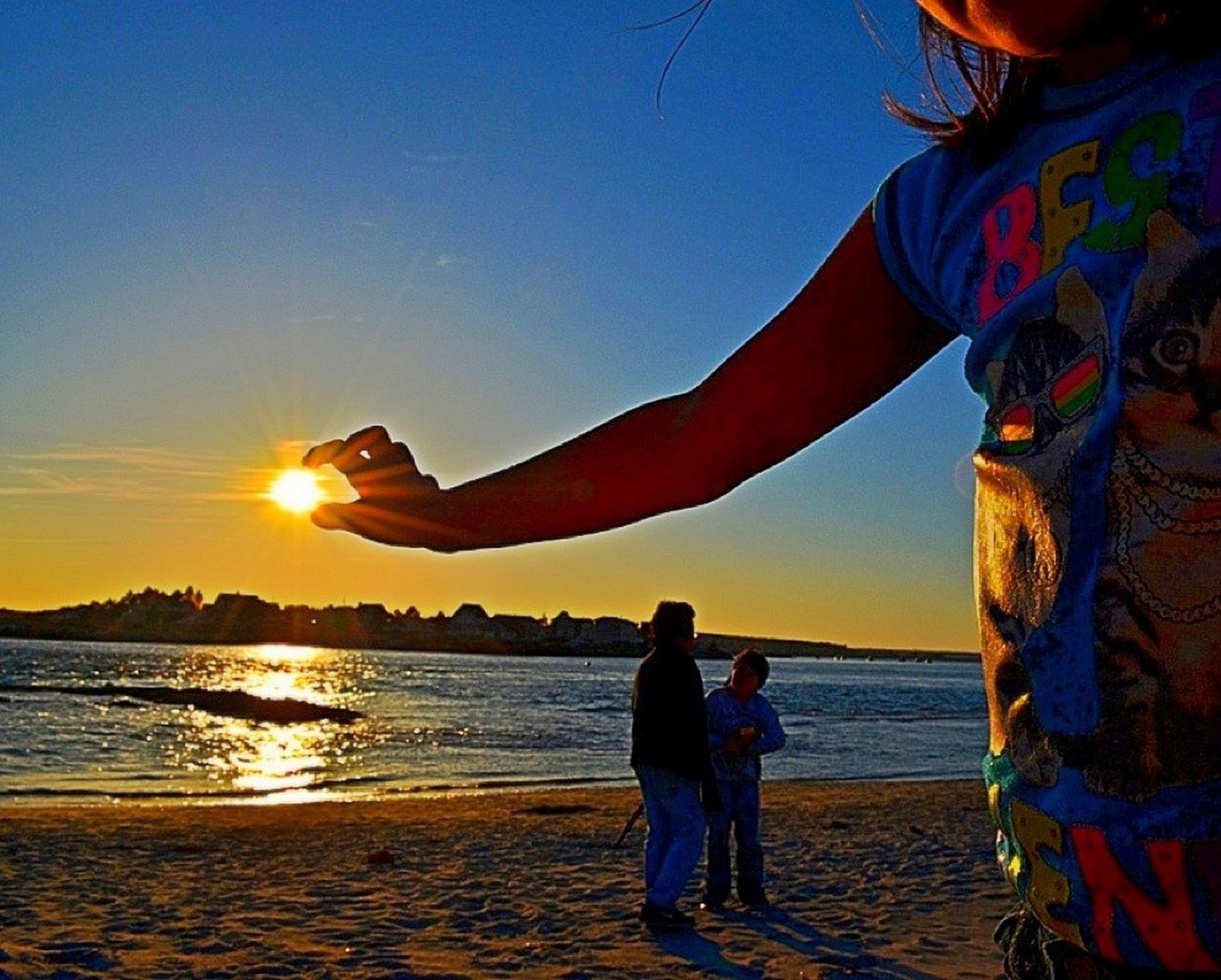 sea, beach, sunset, water, lifestyles, leisure activity, shore, sun, vacations, sand, sky, horizon over water, scenics, tourist, sunlight, person, tranquility