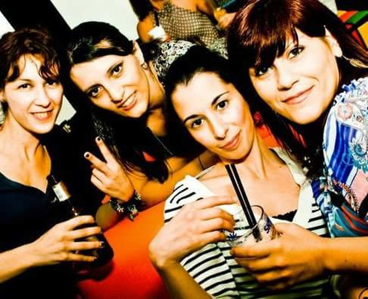 party - social event, happiness, fun, adults only, adult, looking at camera, nightlife, cheerful, smiling, friendship, young adult, portrait, people, young women, night, enjoyment, group of people, indoors, celebration, only women, nightclub, women, clubbing, luck, beautiful people, beautiful woman, social gathering, headshot, togetherness, youth culture, happy hour, beauty, alcohol, real people, close-up