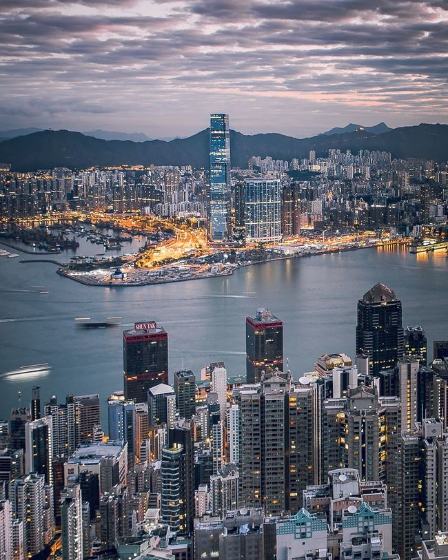 The City Cityscape Architecture Skyscraper Urban Skyline Travel Destinations Night City High Angle View Aerial View Illuminated Dusk Cloud - Sky Downtown District Modern Financial District  City Life Harbor