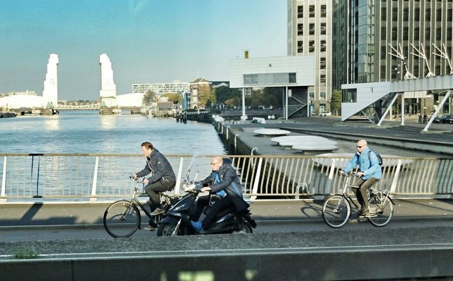 City Young Adult Transportation Bridge - Man Made Structure Outdoors Cycling City Life People River Business Finance And Industry Architecture Real People (c) 2016 Shangita Bose All Rights Reserved Rotterdam Carefree Transportation Bicycle Unitedcycling Windy From My Point Of View Day Horizontal Person