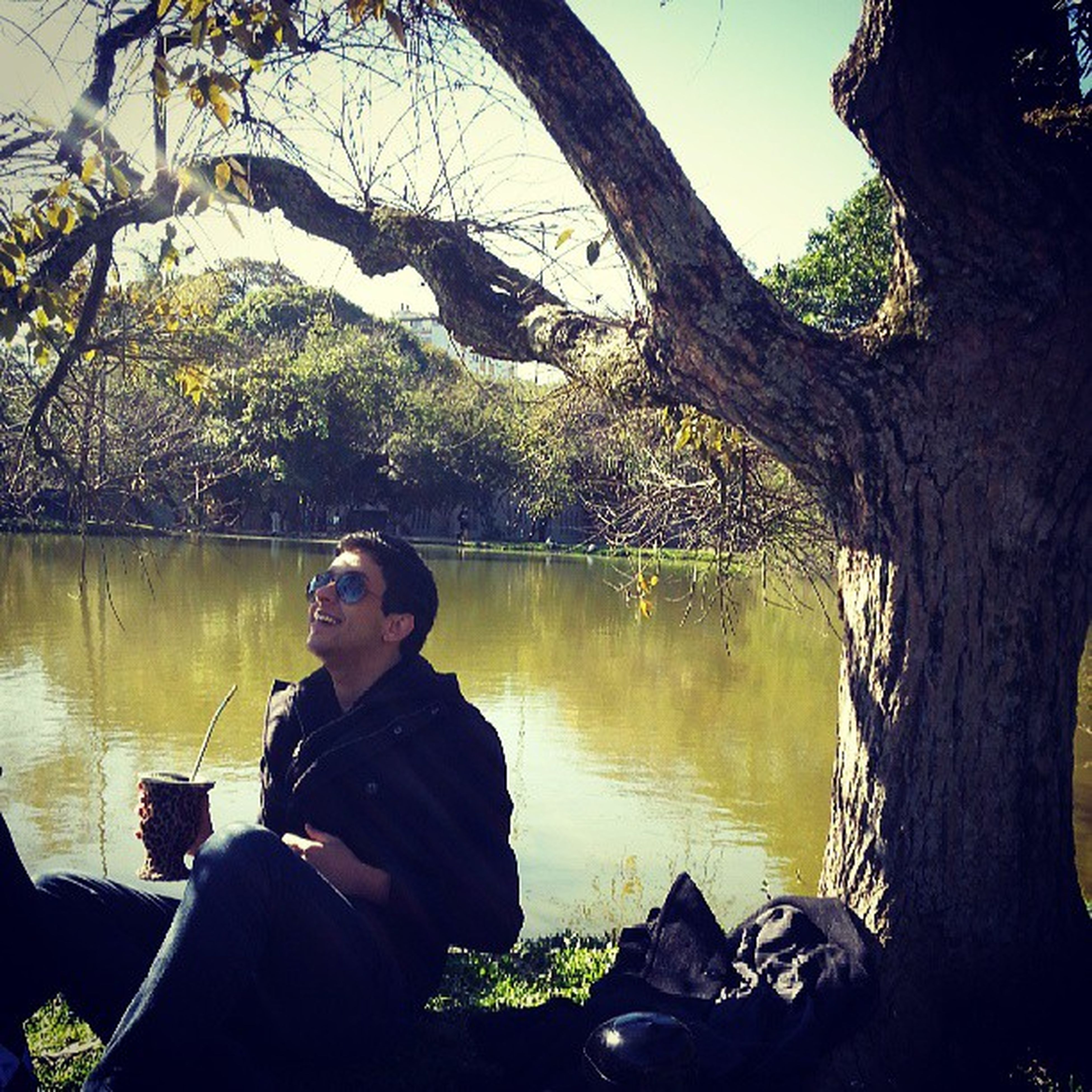 lifestyles, tree, water, leisure activity, lake, young adult, casual clothing, person, sitting, reflection, young men, standing, nature, waist up, three quarter length, looking at camera, tranquility
