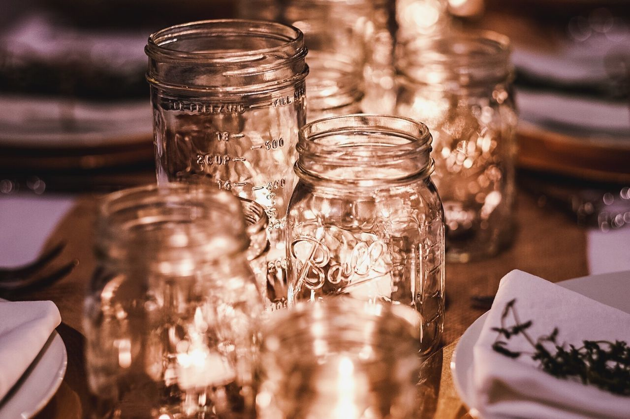 Abundance Bottle Candlelight Candles Celebration Close-up Creativity Dinner Fancy Focus On Foreground Full Frame Indoors  Jar Large Group Of Objects No People Preparation  Religion Side By Side Still Life Table Table Setting Tabletop Variation