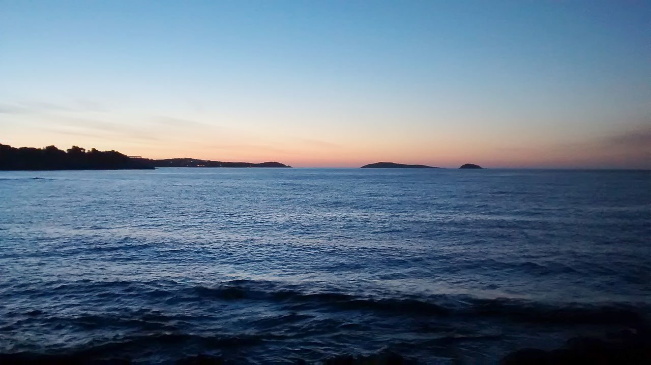sea, beauty in nature, sunset, scenics, nature, tranquility, tranquil scene, water, sky, no people, outdoors, idyllic, waterfront, silhouette, rippled, horizon over water, wave, clear sky, day