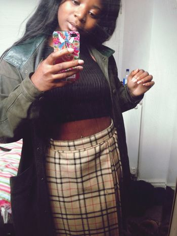 Faux Burberry pleated skirt Vintage wax jacket and lots of Swag