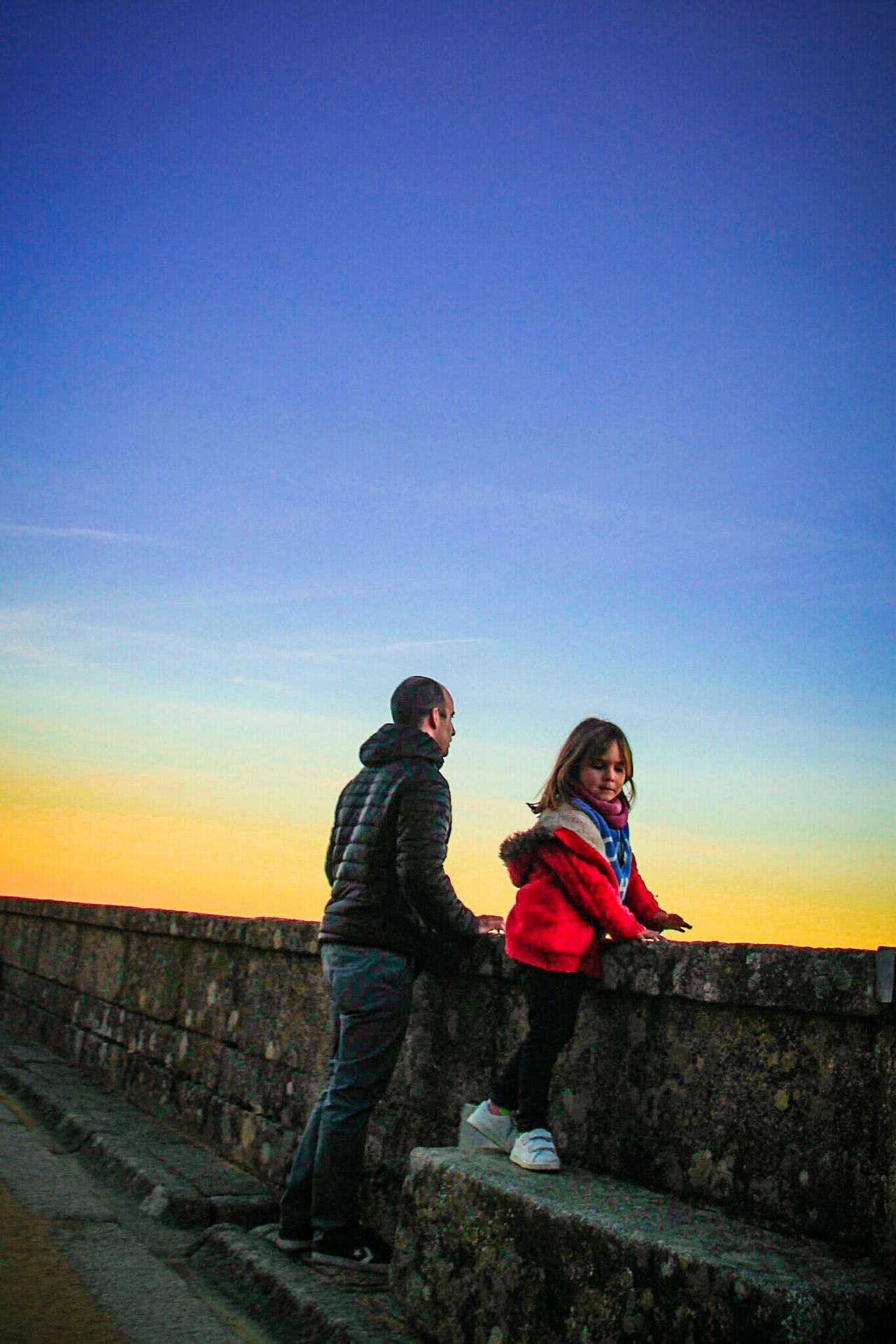 Two People Warm Clothing Blue Winter Travel Destinations People Outdoors Togetherness Sky EyeEm Gallery Check This Out Father And Daughter Sunset Watching The Sunset Enjoying The Moment Elescorial San Lorenzo De El Escorial Knit Hat Scarf Malephotographerofthemonth