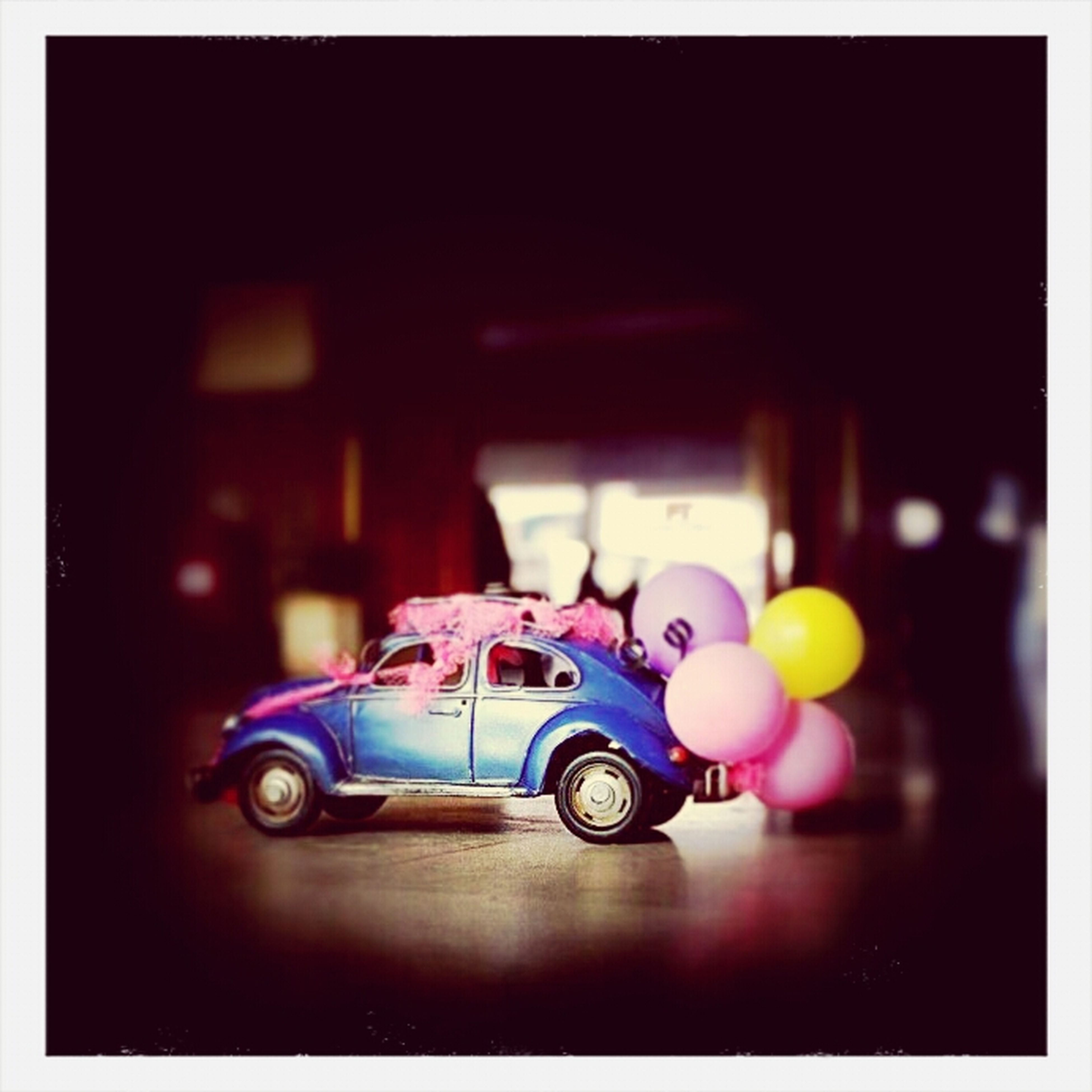 transfer print, auto post production filter, indoors, toy, childhood, multi colored, still life, selective focus, table, no people, close-up, focus on foreground, green color, vignette, blue, illuminated, night, sport, variation