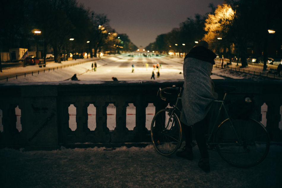 Skating on Nymphenburg Canal Adult Adults Only Bicycle City Cold Illuminated Land Vehicle Leisure Activity Lifestyles Men Mode Of Transport Night One Man Only One Person Only Men Outdoors People Real People Road Skateboarding Skating Street Transportation Tree