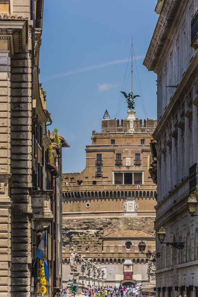 Castel Sant'angelo make its comparison through the medieval streets of Rome Angel Architecture Building Building Exterior Built Structure Castel Sant'Angelo Castle Castle Of Holy Angel Church Culture Exterior Façade Historic History International Landmark Outdoors Religion Rome Spirituality Street Today's Hot Look Travel Urban