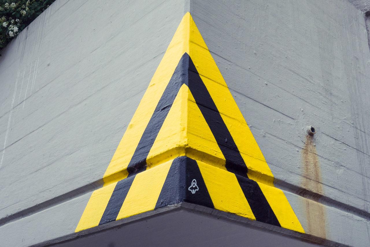 Ungewollt Kunst. Yellow Triangle Shape Day Outdoors Road Transportation No People Road Sign Close-up Street Art/Graffiti Streetart