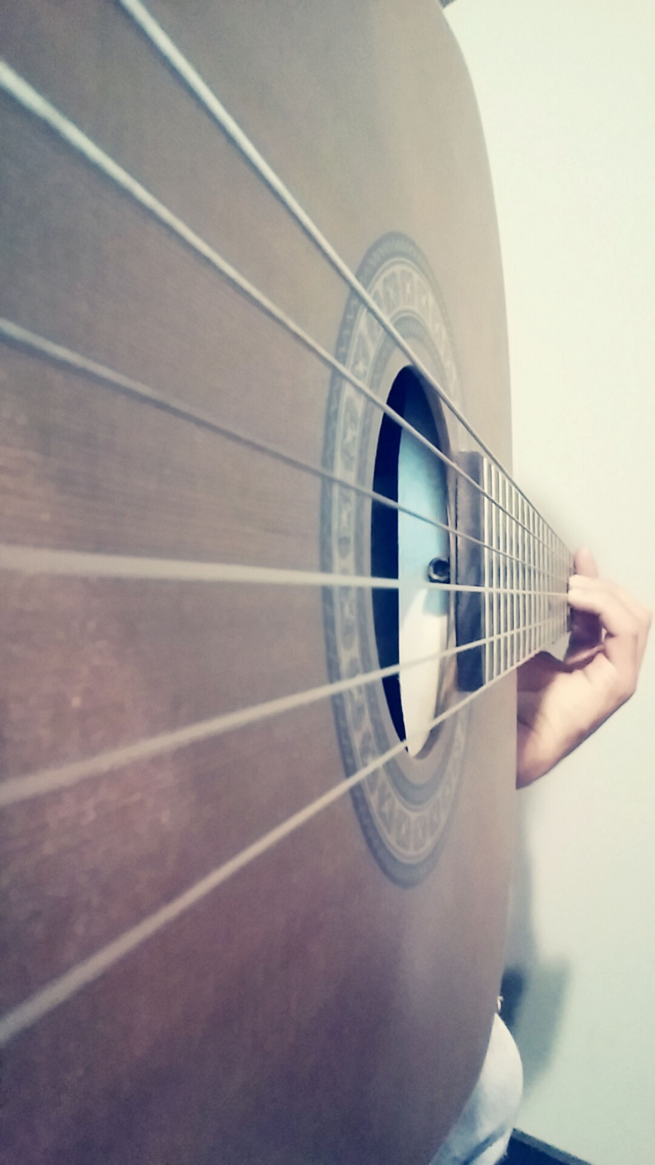 indoors, part of, technology, cropped, music, arts culture and entertainment, guitar, person, musical instrument, close-up, metal, holding, lifestyles, day, men, modern, copy space, leisure activity