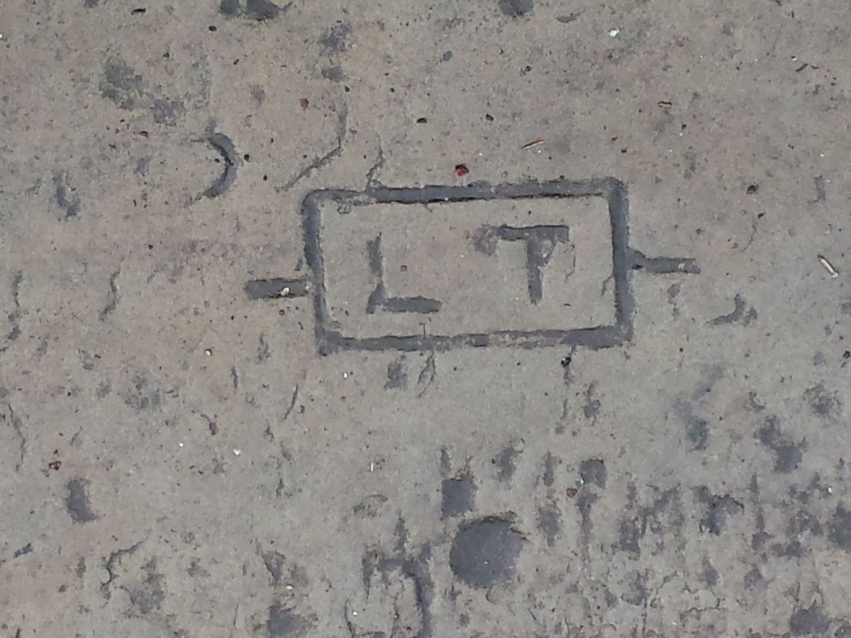 Close-up Found On Street Initials Letters No People Stone Slab Seating Stone Wall