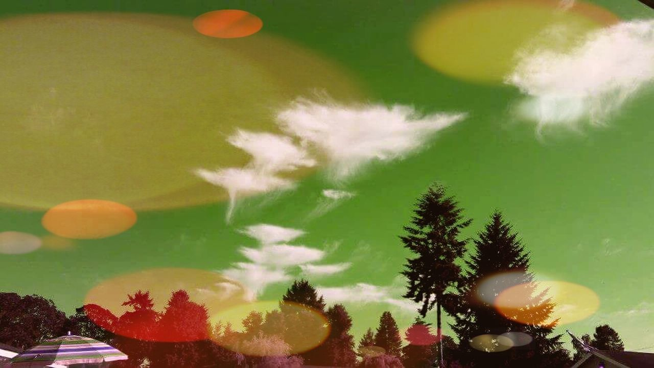 Cosmic space clouds from the 60s Multi Colored Beauty In Nature Cloud - Sky Spaceship Clouds