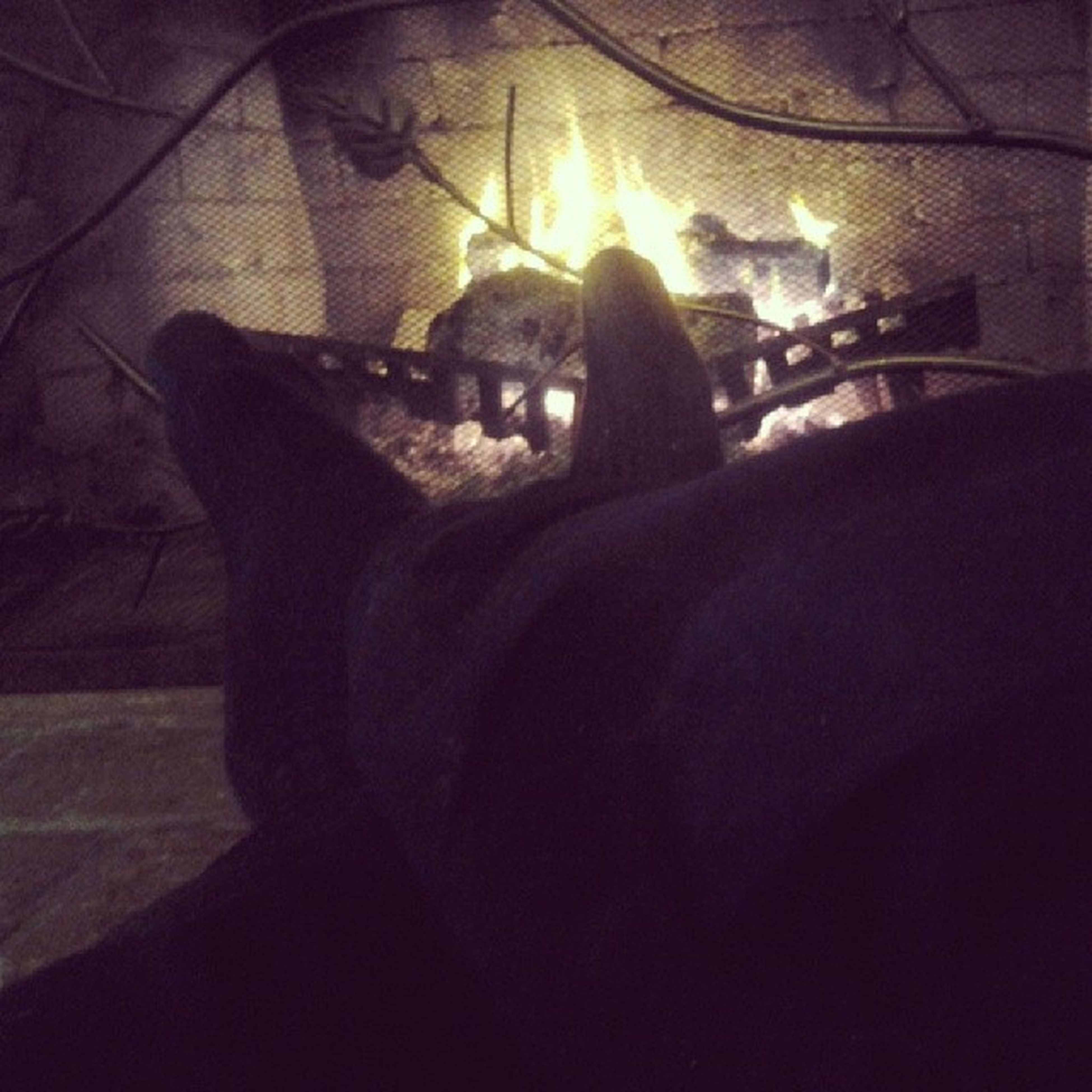 Kicked up my feet after work, enjoying the fire. EnjoyingThis Afterwork NiceFire