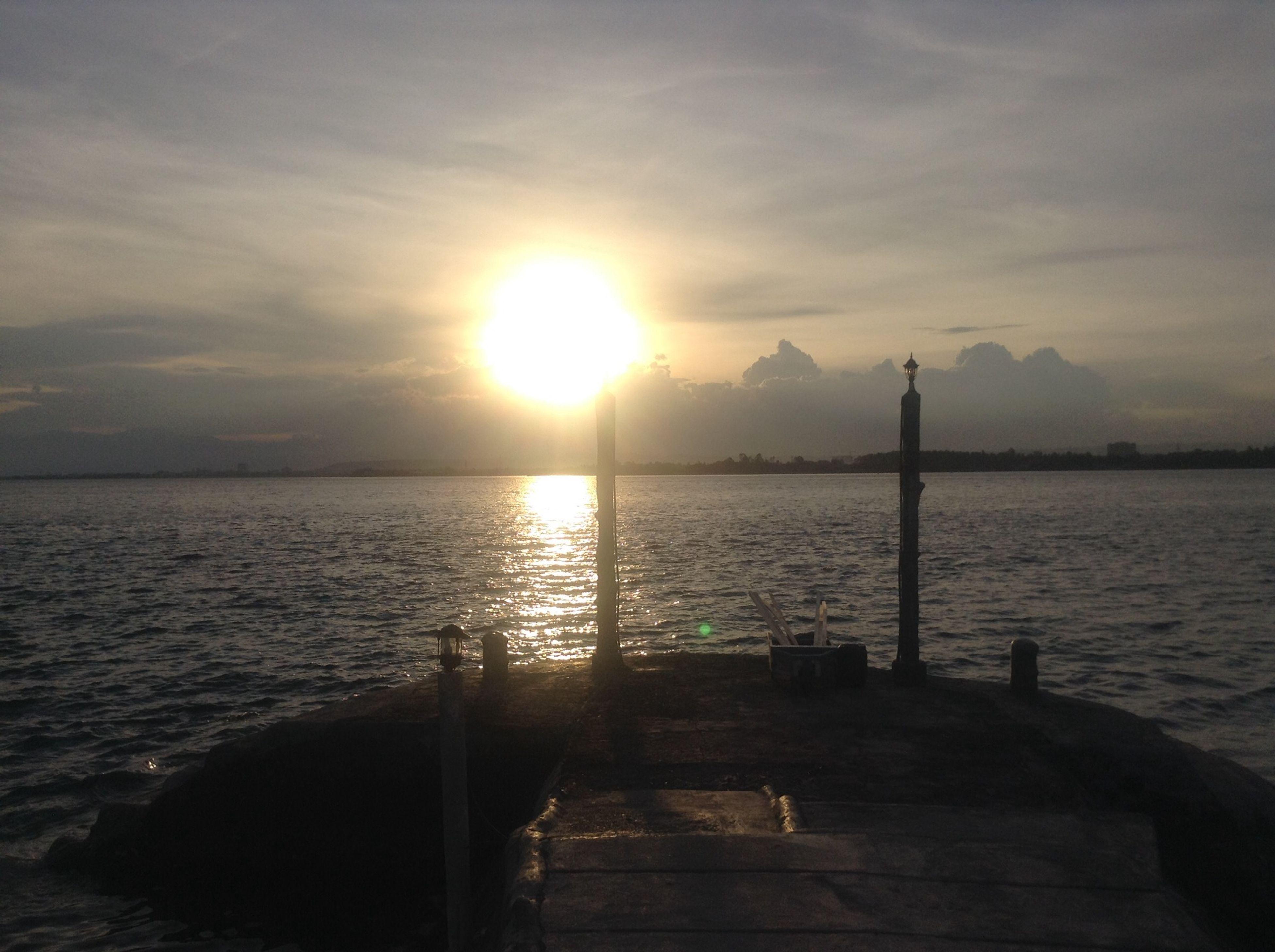 water, sun, sunset, sky, sea, scenics, tranquil scene, tranquility, beauty in nature, transportation, nature, nautical vessel, cloud - sky, silhouette, sunlight, pier, rippled, sunbeam, boat, idyllic