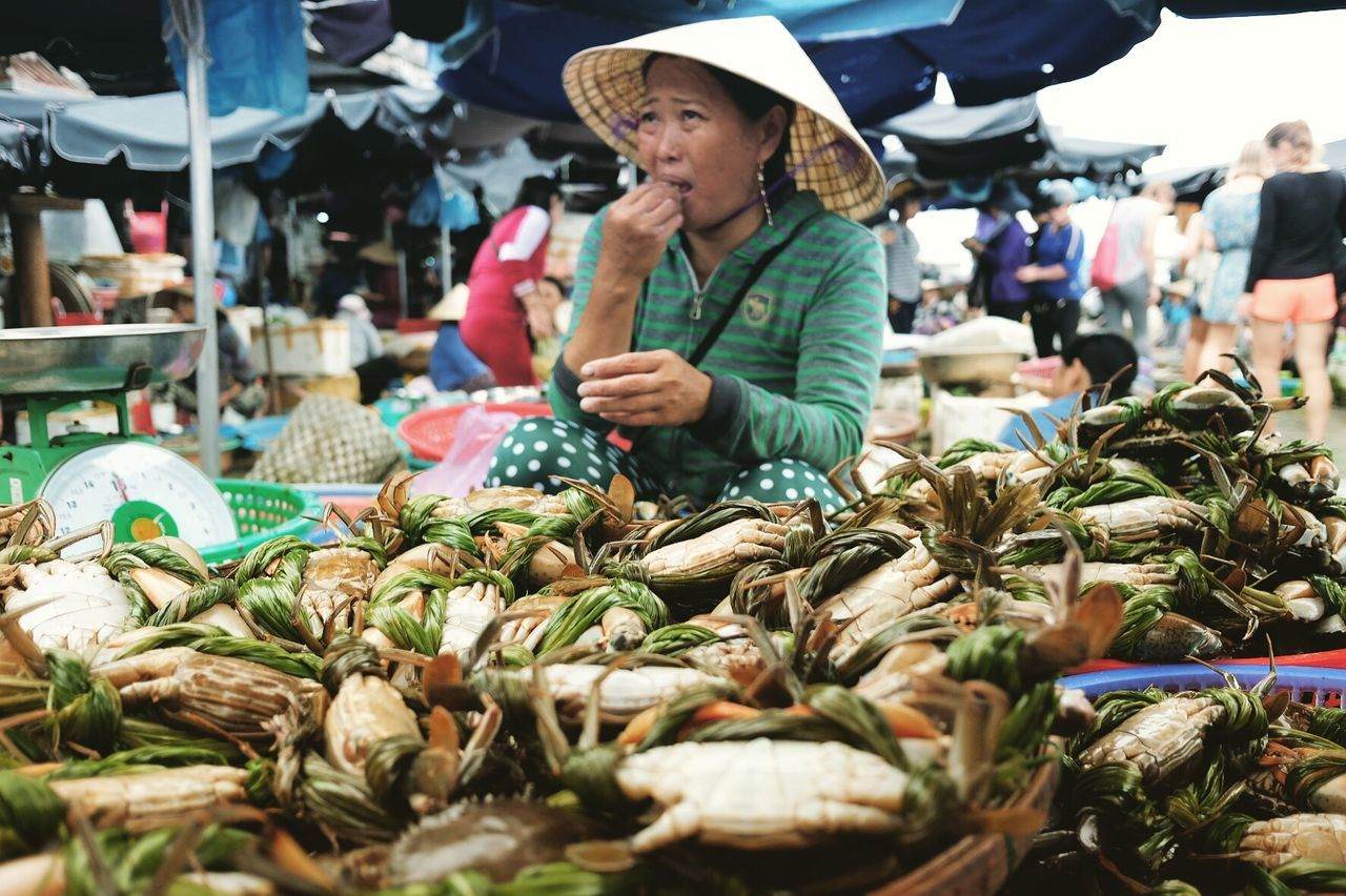 Hoi An Market Retail  Market Stall Crabs Vietnam Hoi An Market Seafoods Food And Drink Business One Mature Woman Only Selling Vegetable Food Mature Adult Small Business Choice Healthy Eating Street Market Market Vendor Mature Women Buying Freshness Real People Women Only Women