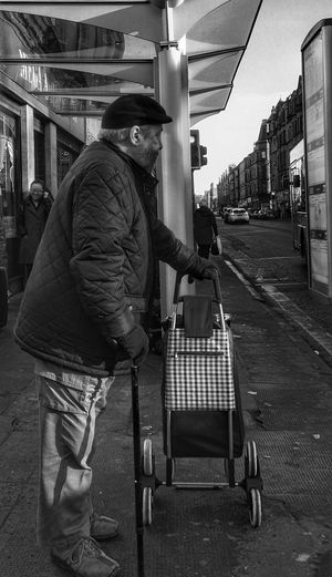 Full Length One Person People One Man Only People Watching Waiting For The Bus Strangers In Transit