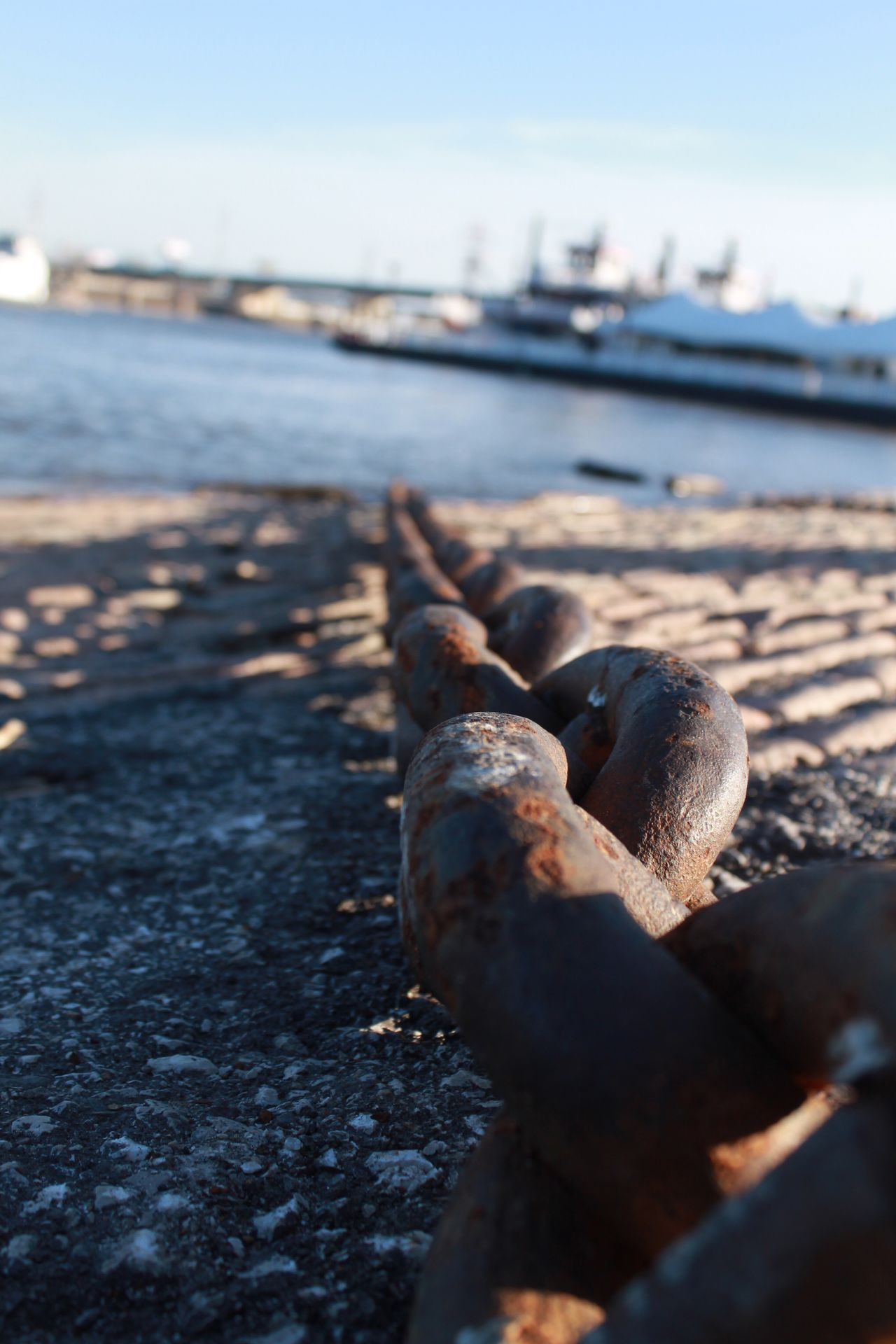 Close Up Outdoors Focus On Foreground Sunlight Close-up Day St Louis Midday Old St Louis Riverfront Landing Lacledes Landing Riverside Chain Boats Boat Anchorage Anchor Bricks Long Rusty Blurred Background BIG Low Shot Low Shots