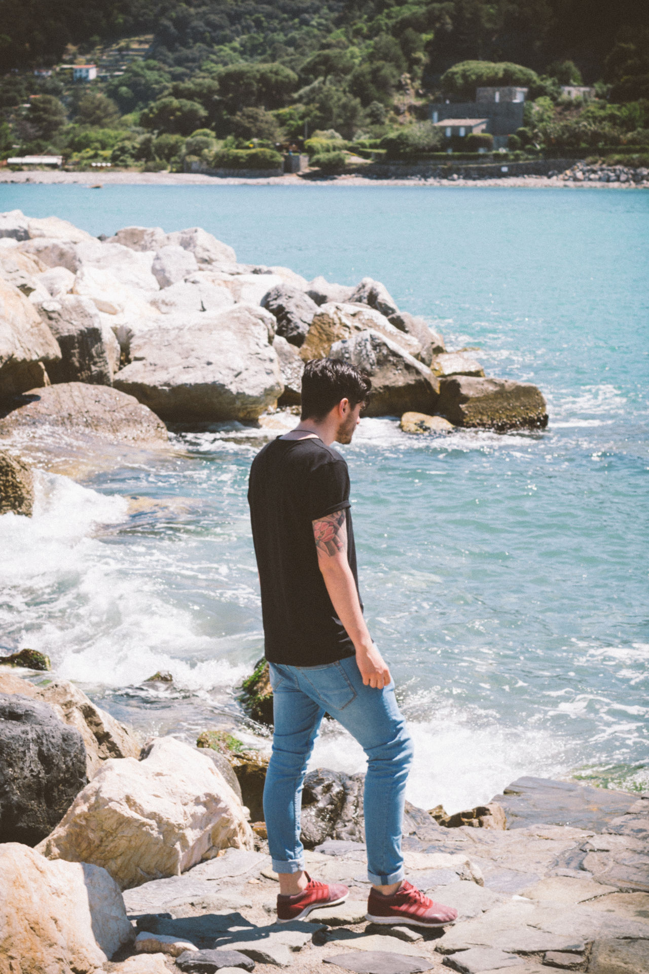 Adult Beach Beauty In Nature Casual Clothing Day Full Length Italy La Spezia Leisure Activity Lifestyles Nature One Person Outdoors People Real People Rear View Rock - Object Sea Sky Standing Water Wave Young Adult Young Men