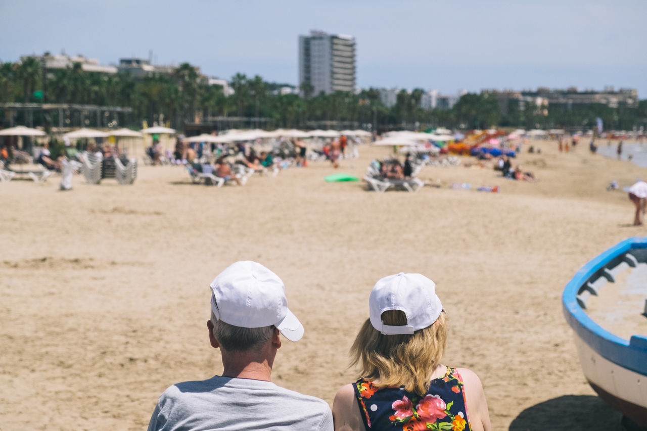 Beach Beach Photography Building Exterior Cap Couple Day Headshot Leisure Activity Live For The Story Men Outdoors People Real People Rear View Sand Sky Summer Togetherness The Street Photographer - 2017 EyeEm Awards