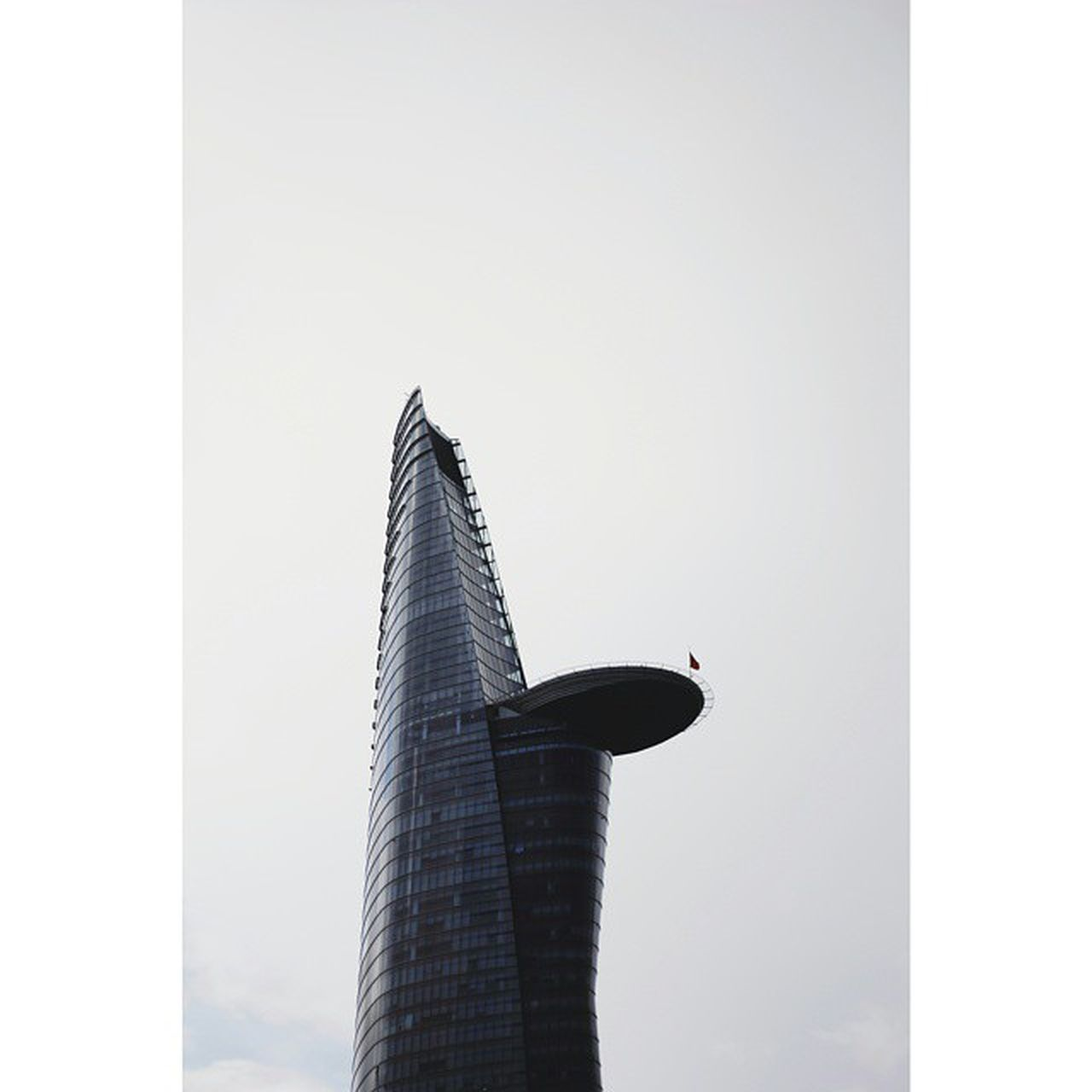 architecture, tower, built structure, building exterior, day, modern, no people, skyscraper, sky, outdoors, clear sky, flying, city