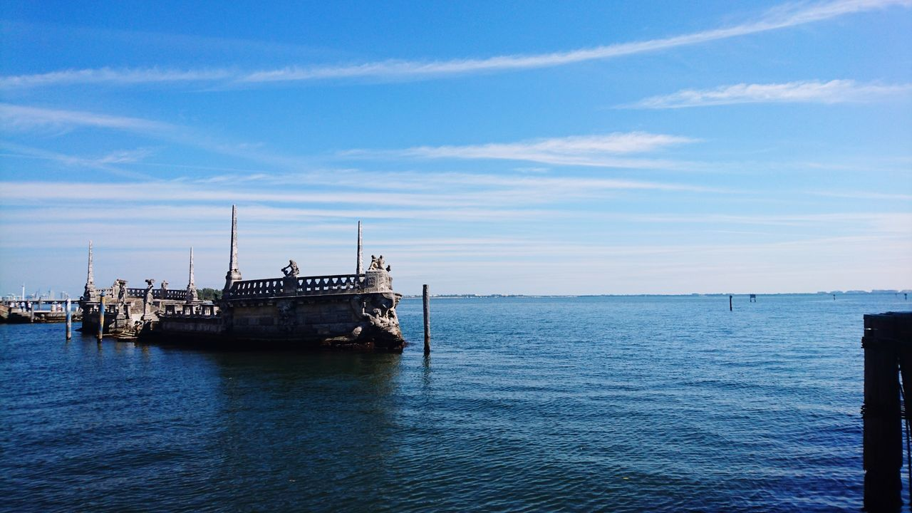 water, sea, nautical vessel, sky, transportation, beauty in nature, tranquil scene, blue, tranquility, nature, day, outdoors, cloud - sky, no people, scenics, horizon over water