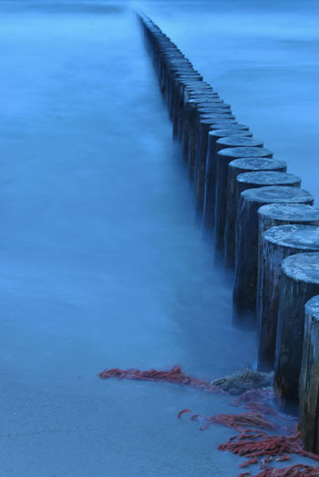 Wooden breakwater shot with long exposure at dawn Autumn Sea Baltic Sea Cold Weather Frozen Waves Long Exposure Shot Rough Nature Rough Waters Rough Sea Absorbing The Energy Breakwater Cold Atmosphere Crashing Waves  Dramatic Scene Dramatic Scenery Impassive Long Exposure Long Exposure Photography Morning Sea Mystical Atmosphere Mystical Sea Mystical Waves Sea At Dawn Unshakable Unyielding Windy Day