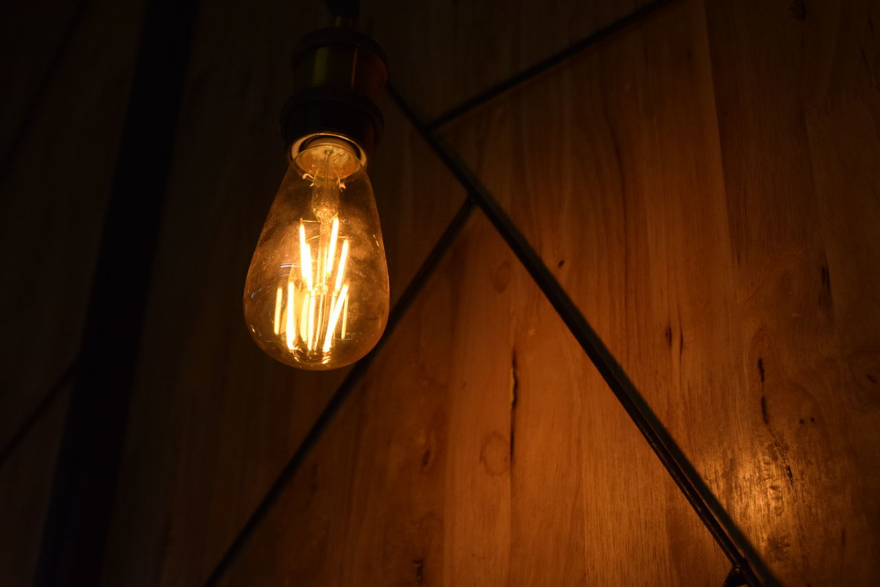 electricity, light bulb, lighting equipment, illuminated, filament, bulb, no people, connection, electric light, hanging, close-up, indoors, technology, cable, fuel and power generation, low angle view