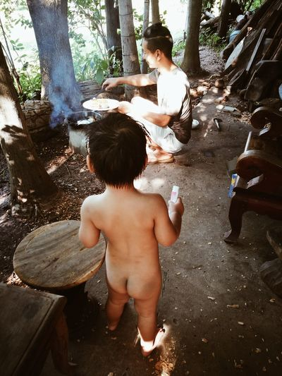 Cooking Shirtless Boys Child Lifestyles Son People Togetherness Children Only Day Family With One Child Childhood Full Length Barefoot Breakfast Egg Enjoying Life Fun Father Love Real People Spraying Family❤ Happiness Home Cute Beautiful