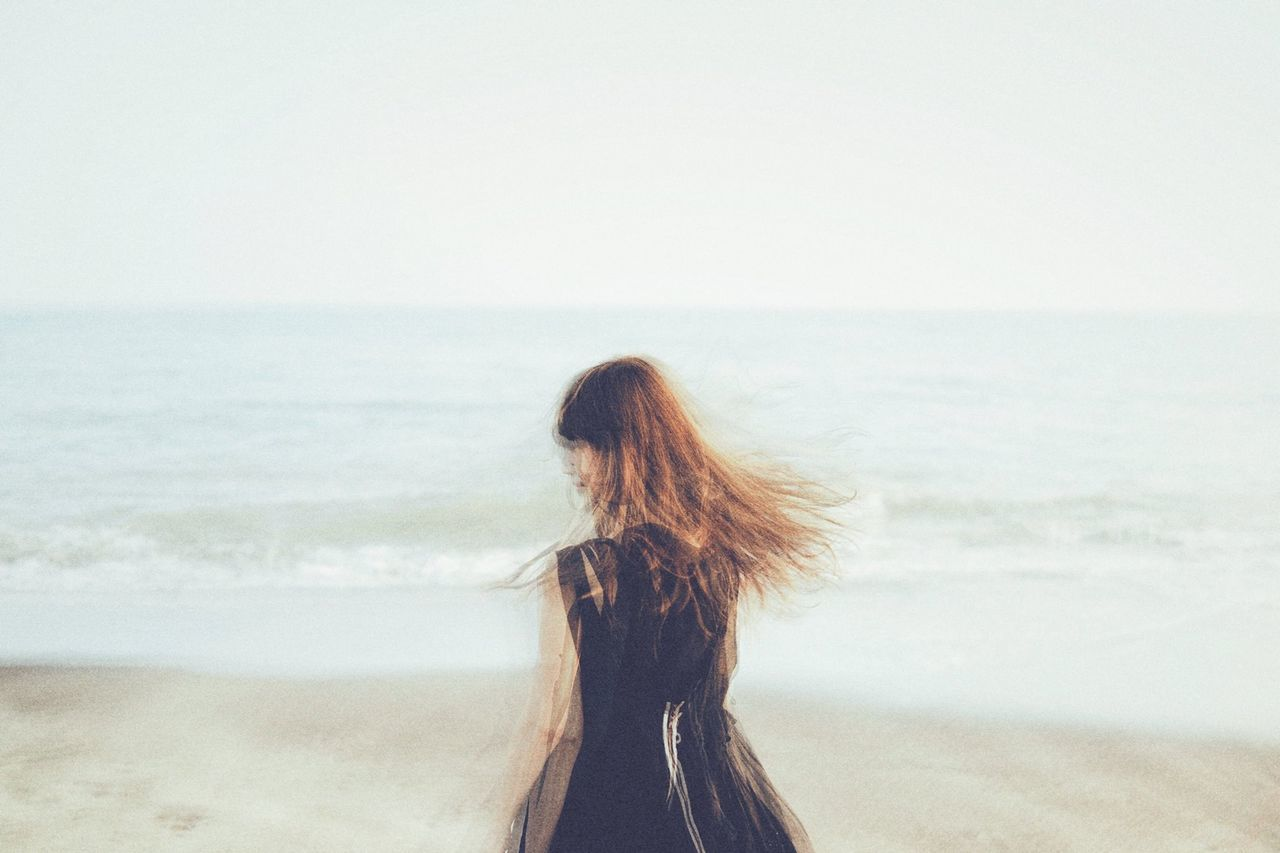 Beautiful stock photos of japan, Beach, Blurred Motion, Brown Hair, Clear Sky