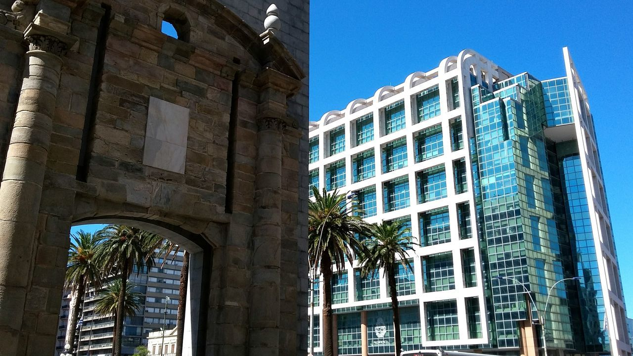 The new and the old meet in the city of Montevideo. Architecture Building Exterior Built Structure Low Angle View Window Travel Destinations Business Finance And Industry Outdoors Day City No People Sky Politics And Government Citadel Glass Curtain Walls Montevideo
