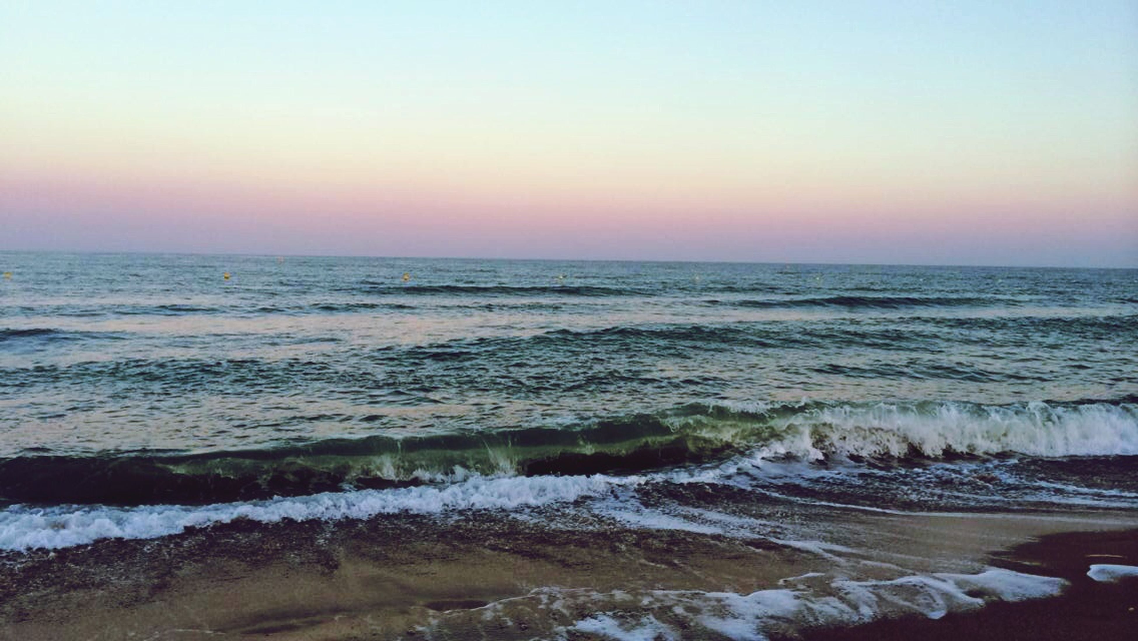 sea, horizon over water, water, beach, scenics, sunset, tranquil scene, beauty in nature, shore, clear sky, tranquility, wave, copy space, nature, idyllic, surf, sky, orange color, remote, non-urban scene