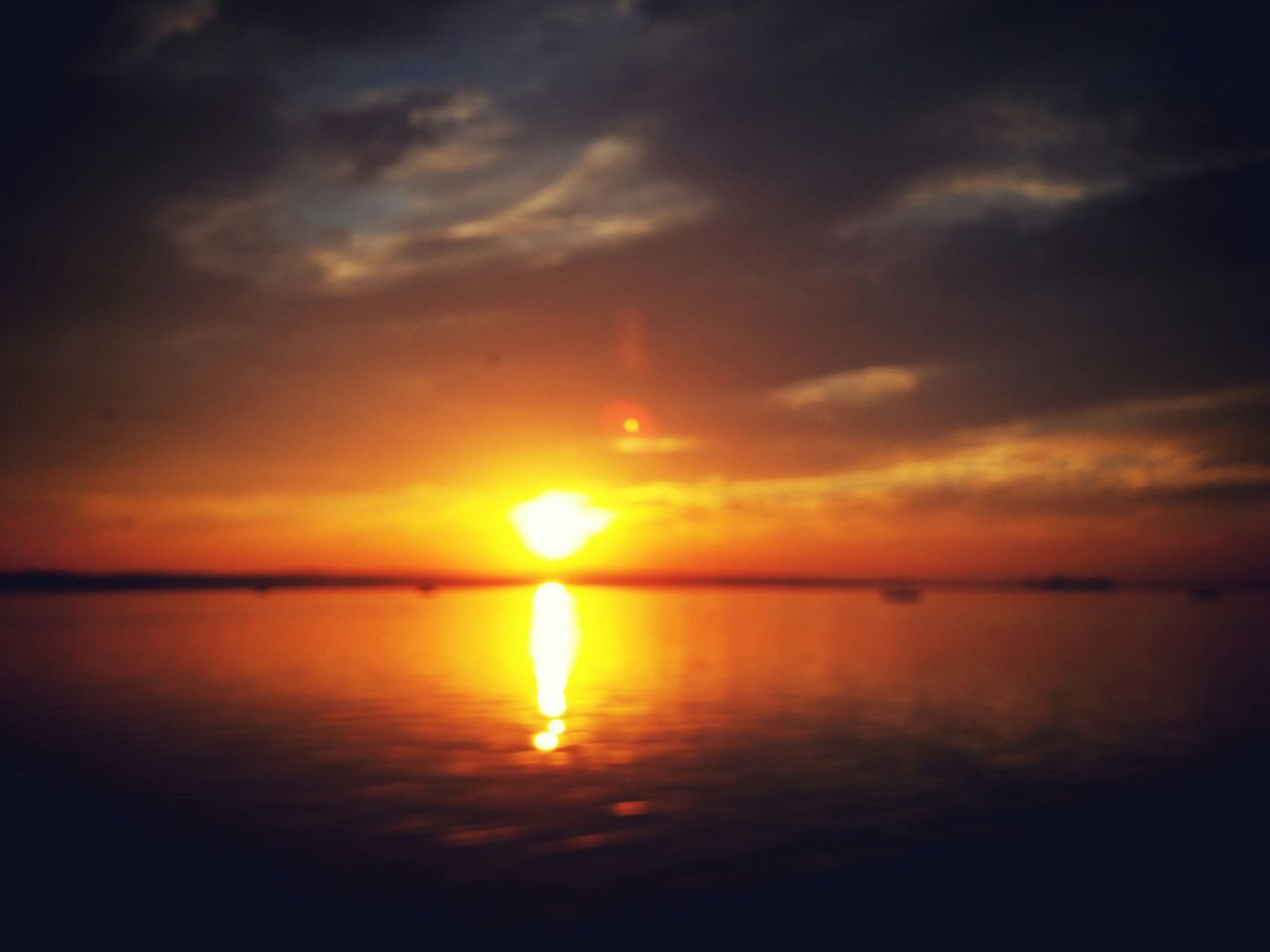 sunset, sun, scenics, nature, beauty in nature, tranquility, sea, reflection, water, tranquil scene, sky, idyllic, no people, silhouette, cloud - sky, waterfront, outdoors, horizon over water, sunlight
