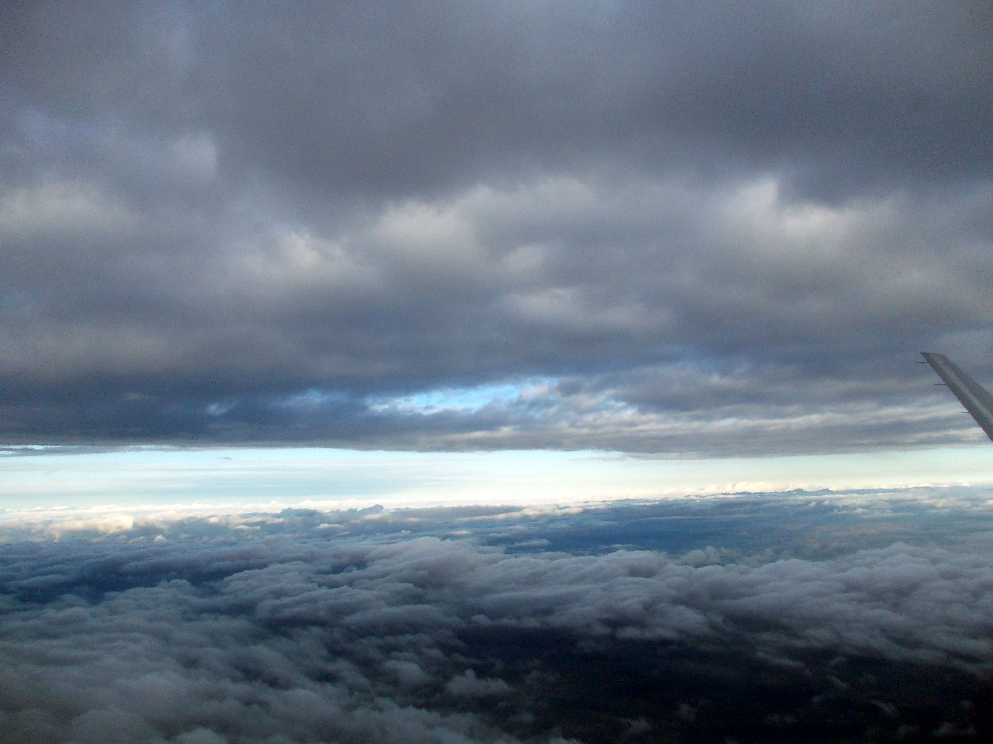 sky, cloud - sky, weather, scenics, cloudy, beauty in nature, tranquil scene, tranquility, cloudscape, nature, overcast, storm cloud, cloud, landscape, airplane, idyllic, dramatic sky, aerial view, atmospheric mood, dusk
