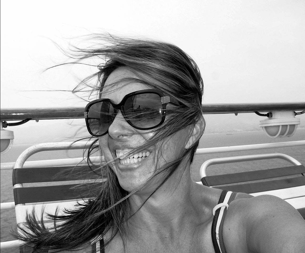 Windblown [BW] ~ Beautiful Woman Blackandwhite Close-up Cruise Daughter Day Eyeglasses  Family Front View Happy Laughing Mediterranean  One Person Outdoors People Photographer In The Shot Portrait Portrait Of A Woman Real People Smiling The Portraitist - 2017 EyeEm Awards Togetherness Windblown Young Adult Young Women