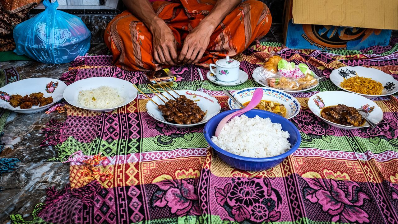 High Angle View Table Indoors  Day One Person Real People Multi Colored Only Women Adults Only Adult Close-up People Food Traditional Wedding Feast Culture Madura INDONESIA